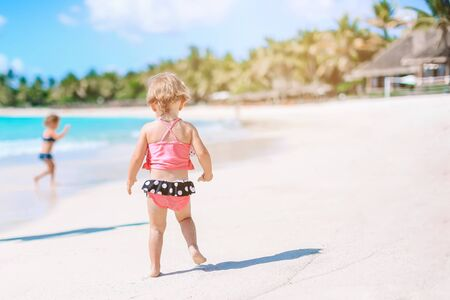 Active little girl at beach having a lot of fun.