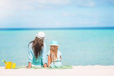 Beautiful mother and daughter at Caribbean beach enjoying summer vacation. Zdjęcie Seryjne
