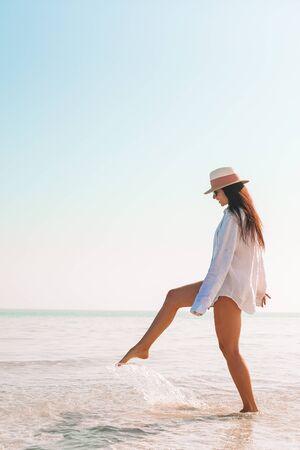 Young beautiful woman relaxing on the beach Stock fotó