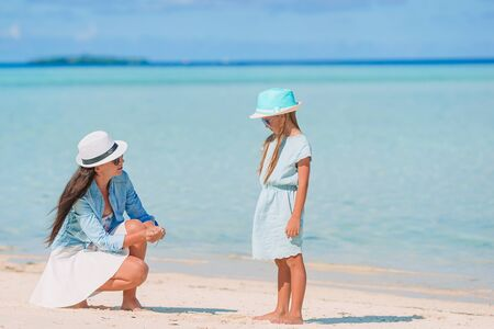 Mom with little daughter on the beach