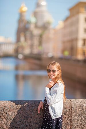 Girl at the summer waterfront in Saint Petersburg outdoors