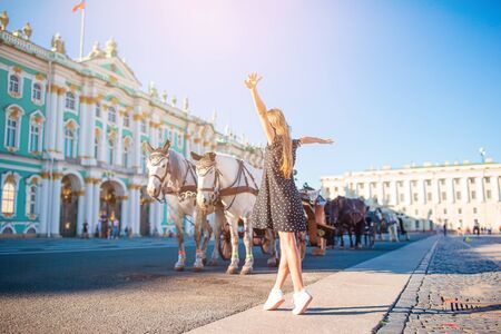 Little girl visiting the Hermitage in Saint-Petersburg.
