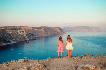 Children outdoor on edge of cliff seashore