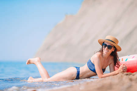 Young woman in hat on the beach vacation