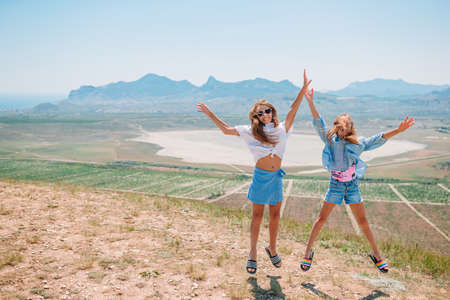 children on vacation on white rock background 版權商用圖片