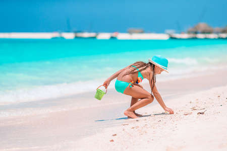 Adorable active little girl at beach during summer vacation 免版税图像