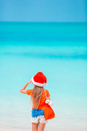 Kid on the beach in Christmas vacation
