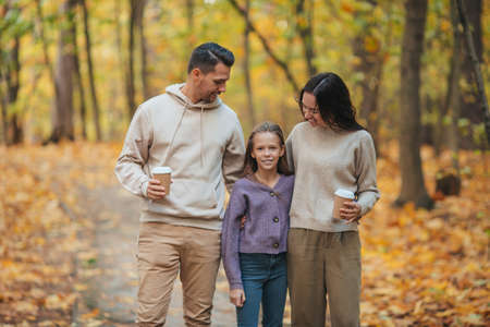 Portrait of happy family of three in autumn day 版權商用圖片