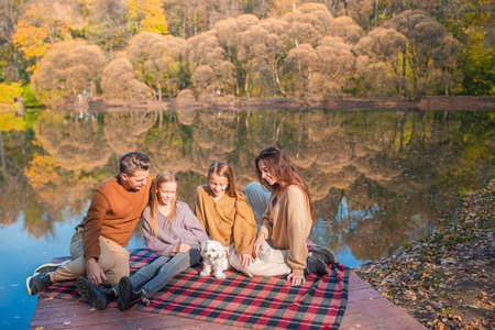 Portrait of happy family in autumn day 版權商用圖片
