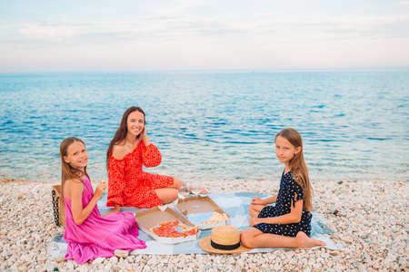 Family having a picnic on the beach