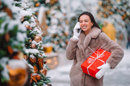 Young mom with kids holding christmas presents Stock fotó