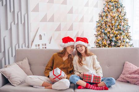 Happy kids holding christmas presents Stock fotó