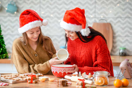 Happy family mother and daughter bake cookies for Christmas Stock fotó