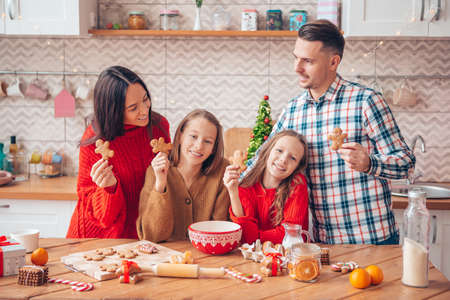 Happy family bake cookies for Christmas Stock fotó