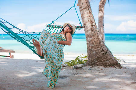 Adorable girl on tropical vacation relaxing in hammock Stock fotó