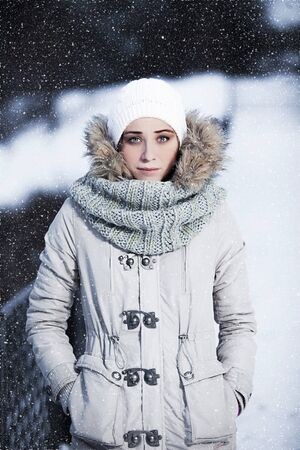 winter photos: portrait of pretty girls in the winter. photos in cold tones Stock Photo