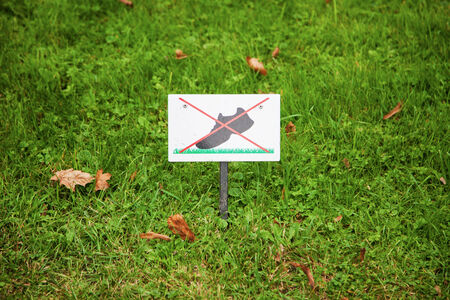 Prohibiting sign on the lawn. On the lawn do not walk photo