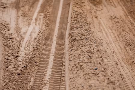 4x4: Off road 4X4 wheel tracks on country desert beach road sand motoring background image