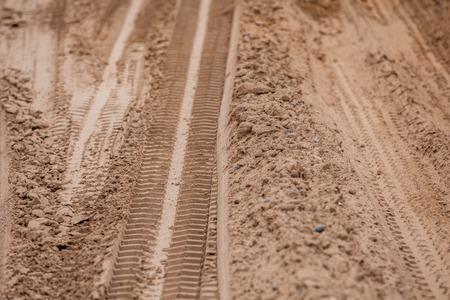 motoring: Off road 4X4 wheel tracks on country desert beach road sand motoring background image