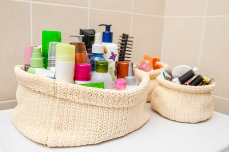 two make up bag with cosmetics and brushes.