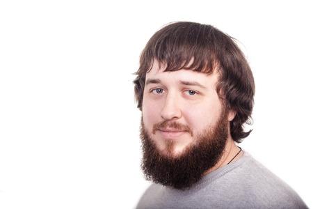 confidently: Bearded man confidently looking forward. Studio shot on white background. Stock Photo