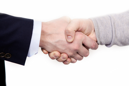 african business man: Multiracial handshake between african and a caucasian business man, isolated on white.