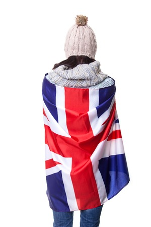 Happy woman laughing and holding the British flag - isolated over white.