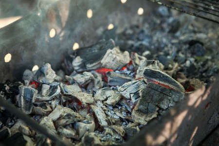 Red hot burning charcoal preparing for grilling.Bbarbecue gril.Soft focus