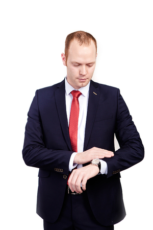 cuff link: businessman in suit and red tie checking time on his wrist watch. mens hand with a watch, watch on a mans hand, the fees of the groom, wedding preparation, preparation for work, mans style on white background, average plan