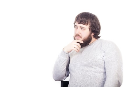 suspicion: Handsome young thoughtful man isolated over white background