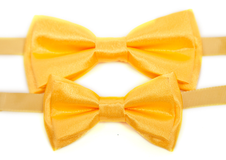 black and white photograph: Yellow two bow tie isolated on white background Stock Photo
