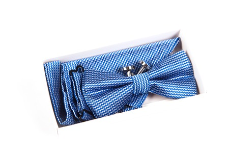 cuff link: Blue bow tie with a pattern on a white background. Accessory for formal dress. Mens and womens accessories. Mens and womens bow tie. Hipster style