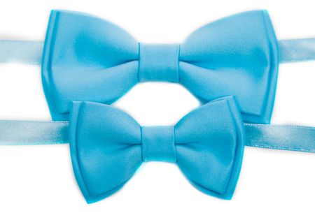 two light blue bow tie isolated on white background, big and small
