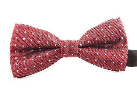 Rode retro boog met witte kleine polka dots op wit geïsoleerd op een witte achtergrond Stockfoto