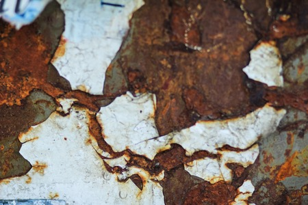 Corrosion of metal. Shabby paint from the surface