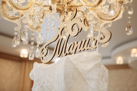 day: Close-up of a delicious wedding dress on a hanger Stock Photo