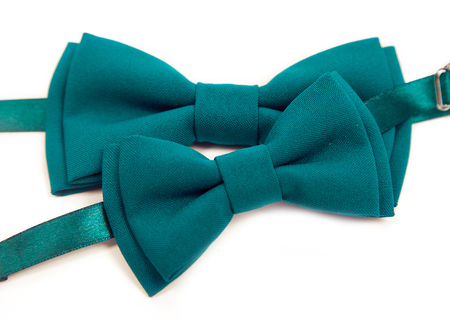 Green bow tie lies on a white table, two bow ties, tie green. Mens Tie, groom preparation, wedding, party