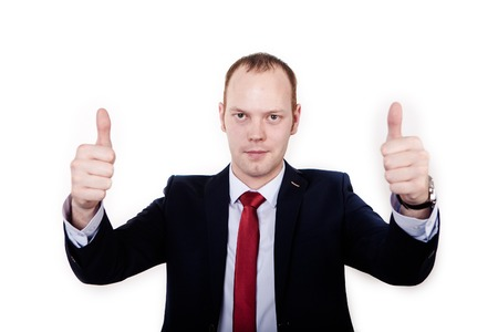 Happy teacher celebrates his success with his arms raised and gives a thumbs up on a white background