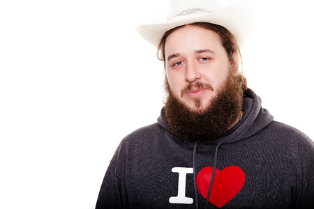 bearded man in a hat look straight on the bright background