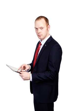 businessman touch tablet or ipad in hand on white background