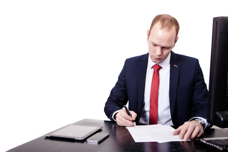 The teacher in suit works at the table in front of white background