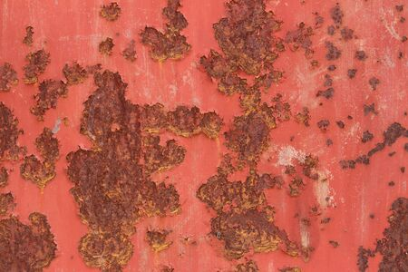 Close up of rusty stains on a old red metal door Stock Photo