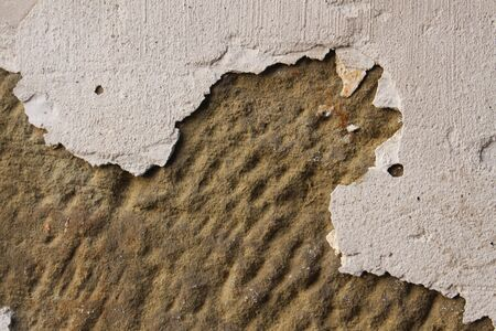 Plaster fallen off a sandstone wall leaving a hole. Can be used as background with text space.