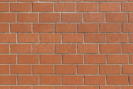 Close up of a new and clean brick wall for use as background or wallpaper Stockfoto