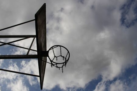 Old basketball chain basket bottom side view before cloudy sky Standard-Bild - 133415727