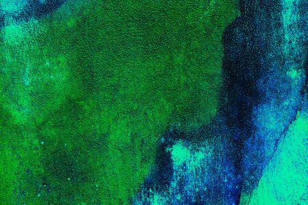 Colored background with marbled textures of different shades of blue, green and mint