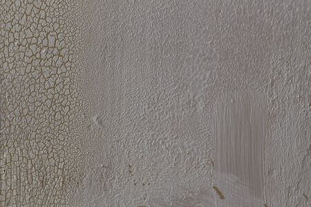 Wall with cracked white paint peeling off