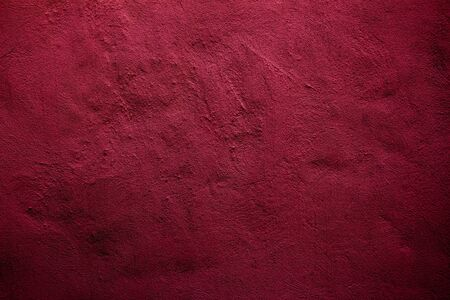 Crimson colored background with textures of different shades of crimson