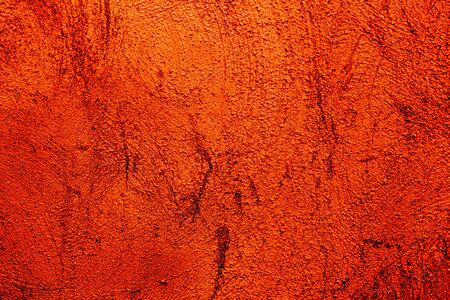 Orange colored abstract wall background with textures of different shades of orange and bright red