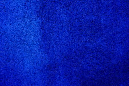 Blue colored abstract wall background with textures of different shades of blues
